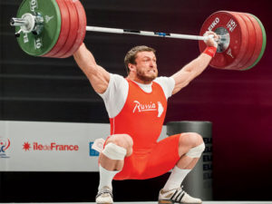 a man lifting heavy weights