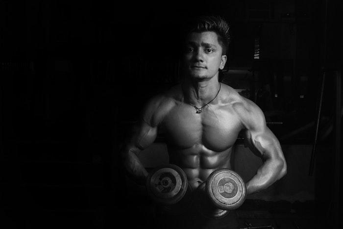 bodybuilder flexing with weights