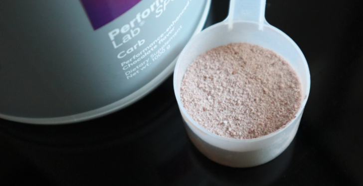 performance lab carb and a scoop of chocolate powder